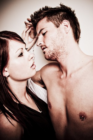 Passionate moment between a young couple - noise added to image photo