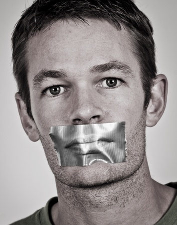 shut: Man with tape over his lips Stock Photo