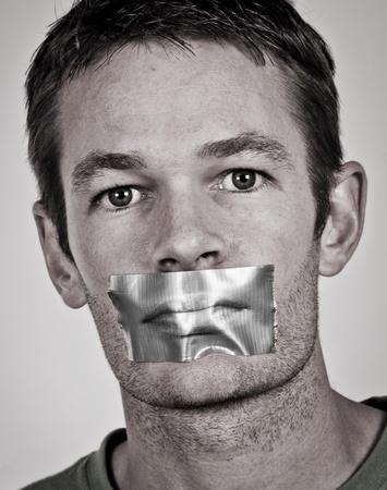 Man with tape over his lips Archivio Fotografico