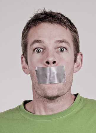 shut: Man with tape over his mouth
