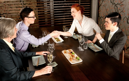 Four people people meeting for lunch
