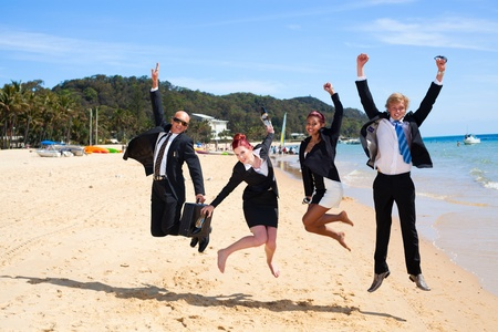4 business people jumping Stock Photo