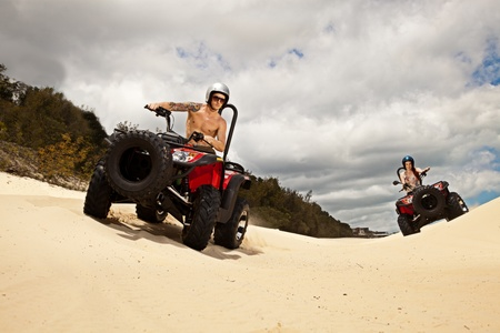 atv: Man and woman on quad bikes Editorial