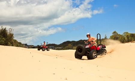 quad: Guy and girl riding a quad bike