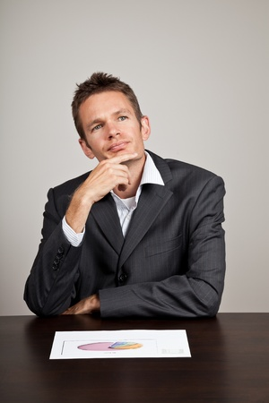 Businessman with a thoughtful expression on his face photo