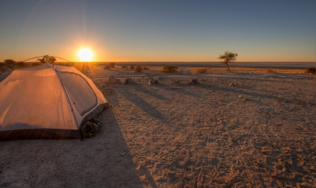 camping: A tent pitched overlooking the makgadikgadi pans