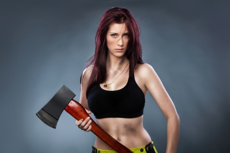 Sexy woman holding an Axe, photo