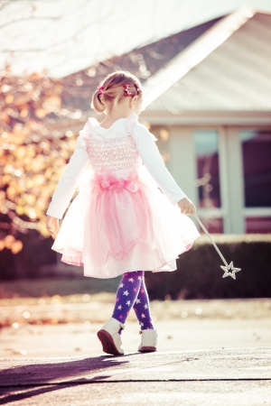 Little girl playing dress ups as a fairy Stock Photo