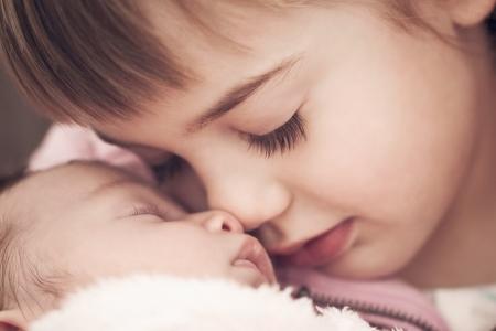 siblings: sibling love Stock Photo