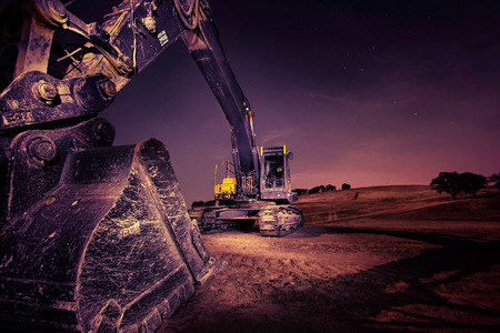 A large excavator at night