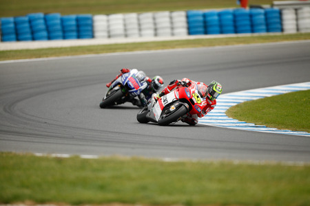 Phillip Island, Australia. 19th Oct, 2014. British rider Cal Crutchlow on bike number 35 overtaking Jorge Lorenzo in the motoGP class at 2014 Tissot Australian Motorcycle Grand Prix Editorial