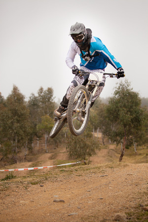 dirt: Person riding a mountain bike on a dirt track