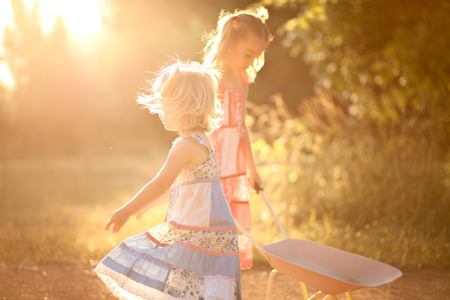 overexposed: Two little girls playing in the sun