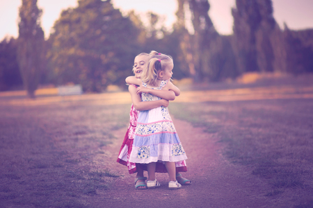 Two little sisters embracing