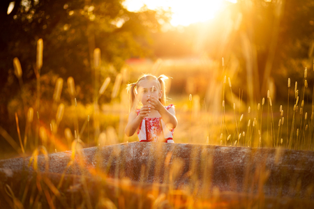 little girl playing in the sun