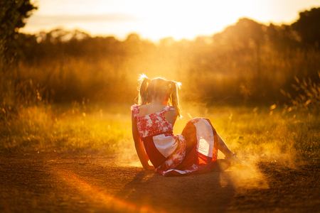overexposed: little girl playing in the dust Stock Photo