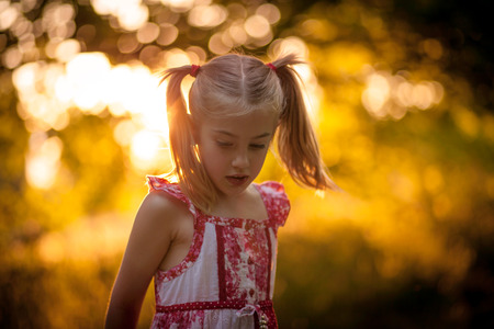Little girl playing outside photo