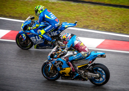 Sepang, Malaysia - October 29, 2017 SHELL MALAYSIA MOTORCYCLE GRAND PRIX 2017 Rider  Jack Miller (EG 0,0 Marc VDS) overtaking Andrea Iannone (Team SUZUKI ECSTAR ) on his way to an 8th place finish