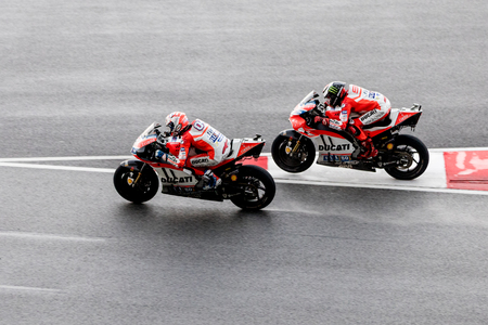 Sepang, Malaysia - October 29, 2017 SHELL MALAYSIA MOTORCYCLE GRAND PRIX 2017 Rider  Andrea Dovizioso (Ducati Team) overtaking his team mate Jorge Lorenzo for the win Editorial