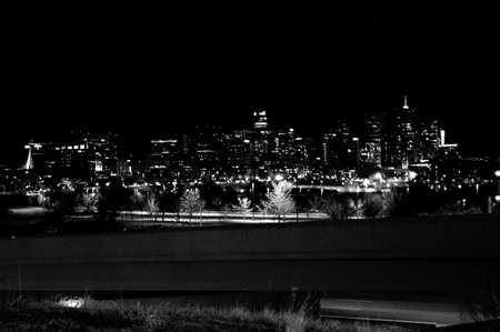mile high city: Downtown Denver Skyline over on ramp night Black and White