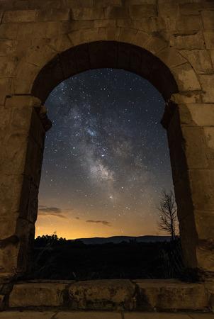 Milky Way seen through a door inside a Church