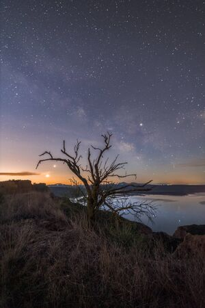 Night landscape with the Milky Way from the mountains of the Castrejon reservoir in the center of Spain