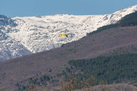 Paramotor flight over the snowy mountains of the mountains of Gredos,Spain