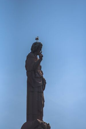Statue of a christ at the entrance to the port of Tarifa,Spain Stock Photo