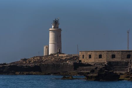 View of the lighthouse of port of Tarifa,Spain