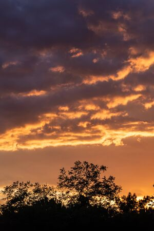 Colorful sunset sky background with reddish colors Archivio Fotografico - 138047118