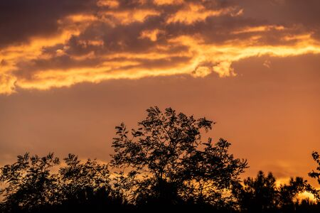 Colorful sunset sky background with reddish colors Archivio Fotografico - 138047096