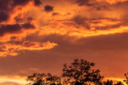 Colorful sunset sky background with reddish colors Archivio Fotografico - 138047182