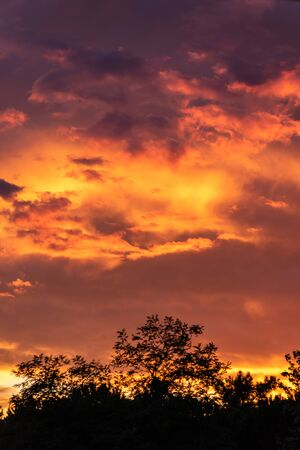 Colorful sunset sky background with reddish colors Archivio Fotografico - 138047371