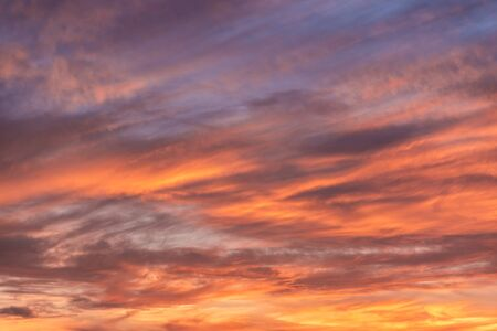 Colorful sunset sky background with reddish colors Archivio Fotografico - 138047450