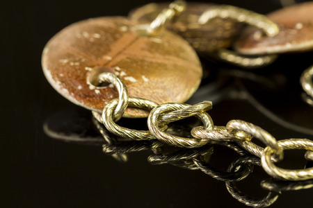 Close up Elegant Golden Chain Fashion Accessories on Top of Glossy Table.