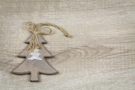 seasonal greeting: Christmas background with a rustic star and snowflake on a wood grain texture with copyspace for your seasonal greeting Stock Photo