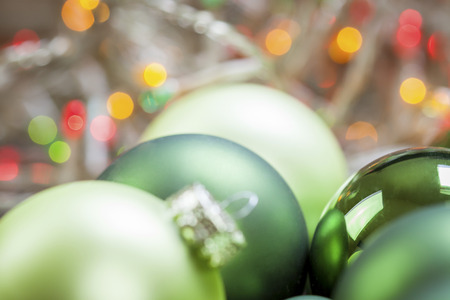 themed: Colorful Christmas background of themed green baubles in assorted sizes and shades in a full frame close up view