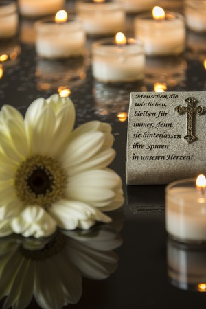 funeral: Funeral card and memorial candlelight on black background  Stock Photo