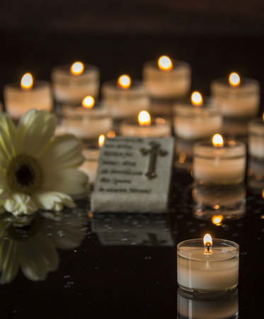 vigil: memorial candlelight on black background