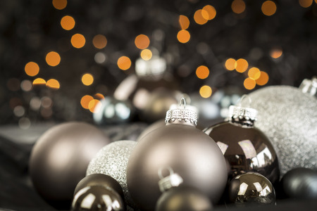 shiny christmas baubles: Monochrome Close Up Still Life of Festive Christmas Balls in Variety of Textures and Hues in Selective Focus with Copy Space Stock Photo