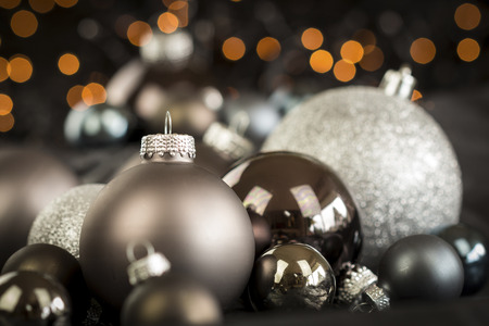themed: Monochrome Close Up Still Life of Festive Christmas Balls in Variety of Textures and Hues in Selective Focus with Copy Space Stock Photo