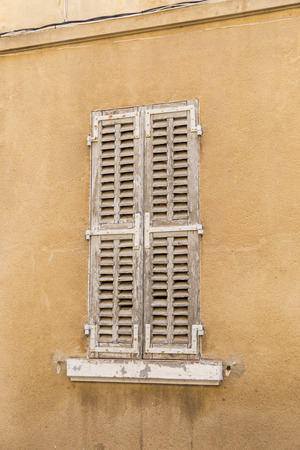 disrepair: Exterior view of old shutters on window Stock Photo