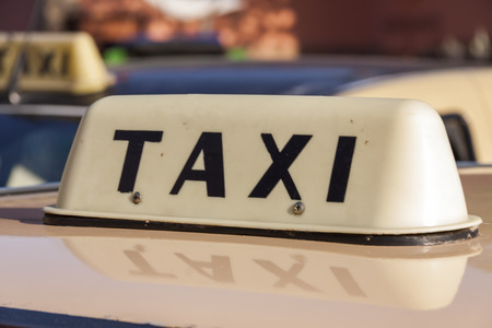 marrakesh: Single taxi sign on top of car in Marrakesh