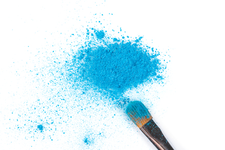 applicator: High Angle Still Life of Make-Up Brush Applicator with Bright Blue Eyeshadow Cosmetic Powder Scattered on White Background with Copy Space