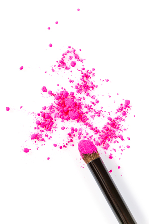 scattered on white background: High Angle Still Life of Make-Up Brush Applicator with Bright Pink Eyeshadow Cosmetic Powder Scattered on White Background with Copy Space Stock Photo