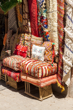 marrakesh: Multicolored cushions and rugs on display in a Marrakesh market
