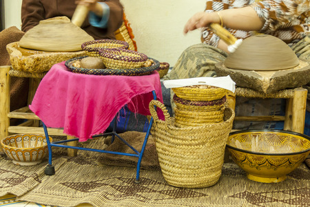 african basket: African basket weavers creating and selling straw baskets