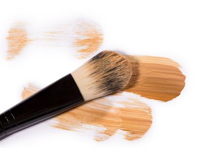 daubs: Trio of Beige Face Base Foundation Color in Different Shades Swiped Across White Background with Copy Space - Abstract Cosmetics Background