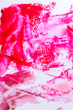 smears: Various smudged random red or pink paint smears over white as abstract background