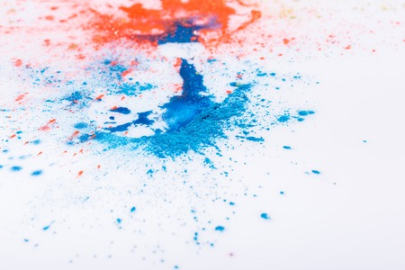 splotches: Abstract splashed and splattered splotches of colorful pink, gold, orange and blue paint over white
